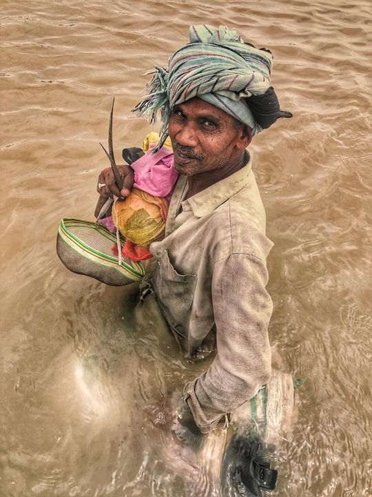 I found this interesting peasant  today while crossing the river Ganges .